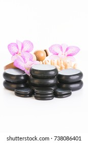 Spa therapy with hot stones, massage roller and cellulite massager
