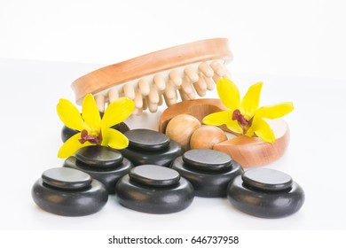 Spa therapy with hot stones, massager roller and cellulite massager