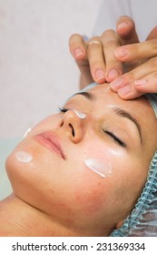 Spa therapy for young woman receiving facial mask at beauty salon.Cosmetic truant, spa, beauty, skin, rubber mask - the concept of skin care. Article about cosmetology.