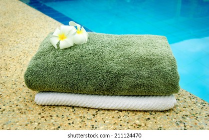 spa towels near the swimming pool.