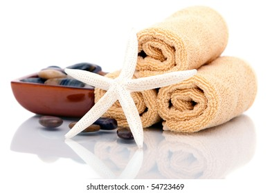 Spa towels with starfish and pebbles