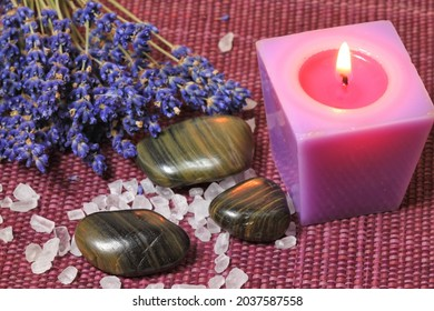 Spa treatment: aromatherapy candle, seasalt and massage stones.