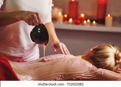 Spa treatment. Back massage with a moisturizing mask. The process of applying a mask. Deep moisturizing and rejuvenating treatments