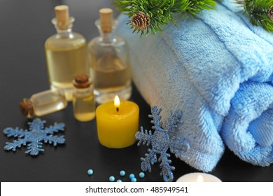 Spa treatment with Christmas decorations on wooden background