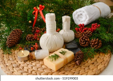 Spa treatment with Christmas decorations on wicker woven mat  - Shutterstock ID 519199003