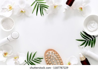 Spa treatment concept, flat lay composition with natural cosmetic products peeling and massage brushes, view from above, blank space for a text