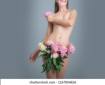 Spa treatment. Flowers instead of clothes, fashion concept. Beautiful tender young girl with pink flowers, spring, sexy body without fat, athletic woman. No cellulite. Young sexy naked woman getting