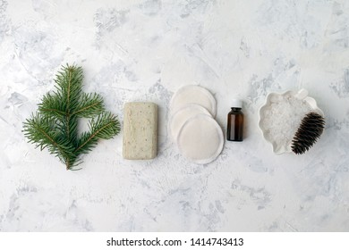 Spa treatment on light background. Spa accessories composition on white table. Natural aroma oil, sea salt, sisal, natural soap. Healthy skin care. SPA, zero waste concept