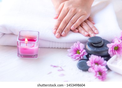 Spa treatment and product for female feet and manicure nails spa with pink flower and rock stone, copy space, select focus, Thailand. Healthy Concept