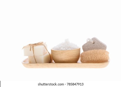 Spa and treatment settting with coconut soap,luffa scrub and sea salz on wooden tray isolated over white background with clipping path
