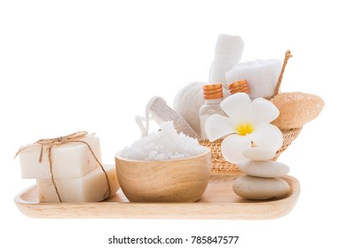 Spa and treatment settting with essential oils,zen stone, towels,coconut soap and frangipani flowers on wooden table isolated over white background with clipping path