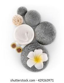 Spa treatment with stones and cream isolated on white