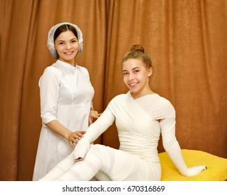 Spa treatment. STYX wrap. Anti-cellulite treatment. The cosmetologist and the client during the procedure.