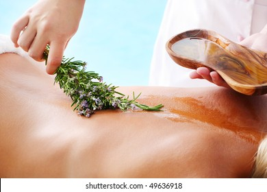 Spa Treatment - woman undergoing  spa treatment with olive oil and herbs.