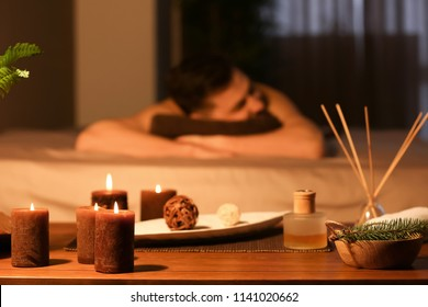 Spa treatments with blurred man on background indoors
