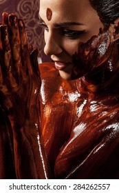 Spa treatments: chocolate body wraps. Woman covered in melted chocolate.