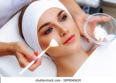 Spa treatments for the face. Chemical peeling. Natural face mask in a beauty salon.