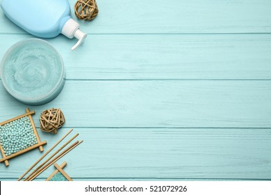 Spa treatments on blue wooden background