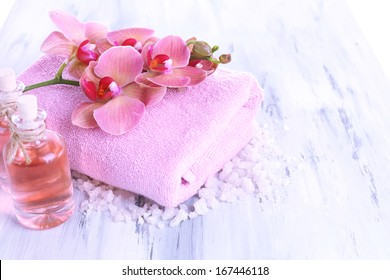 Spa treatments on color wooden background