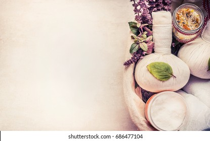 Spa or wellness background with herbal equipment for massage and relaxing treatment, top view