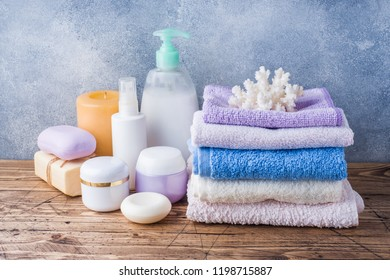 Spa and Wellness concept on wooden background. Towels cream soap and bath accessories
