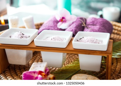 Spa and wellness. Natural bath salt and towels with orchid flower. Spa treatment