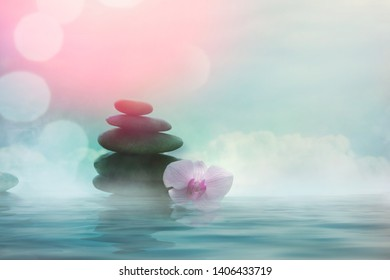 Spa and wellness. Natural massage stones  with orchid flower .Spa treatment