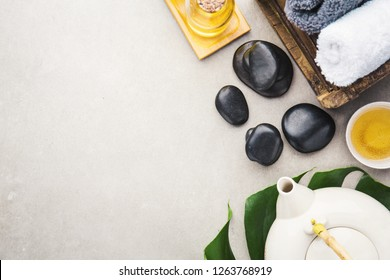Spa Wellness Relax concept. Spa background with spa accessories on grey background. View from above with copy space.