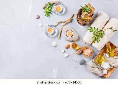 Spa wellness setting concept. Assortment of essential oil cream sea salt natural soap candles and towel. Copy space background, top view flat lay