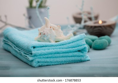 Spa and wellness setting with flowers, candles and towel. Blue dayspa nature set with copyspace