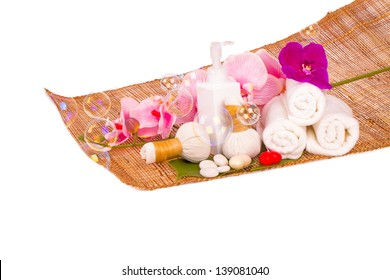 Spa and wellness setting with natural soap, candles and towel