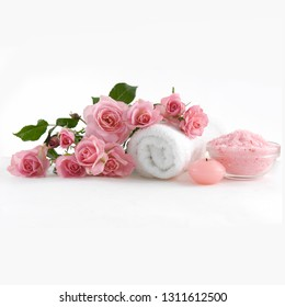 Spa and wellness setting with rose flower, sea salt, oil in bowl, towel, candle on white background