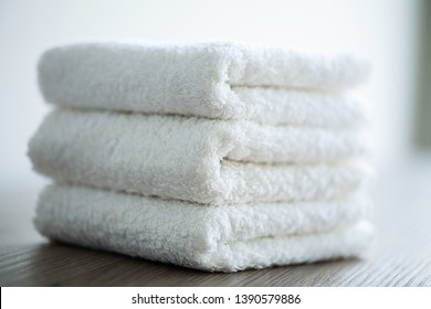Spa. White Cotton Towels Use In Spa Bathroom. Towel Concept. Photo For Hotels and Massage Parlors. Purity and Softness. Towel Textile