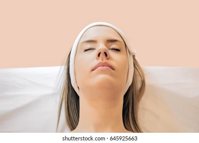 Spa Woman. Beautiful Woman Relaxes on Bed . Face care. picture of calm beautiful woman in massage salon.  Beauty Treatment.