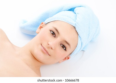 spa woman in blue towel on white background