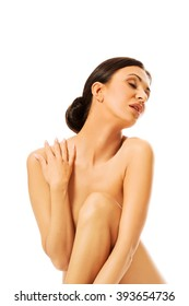 Spa woman sitting, touching her shoulder