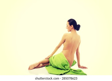Spa woman sitting wrapped in towel.