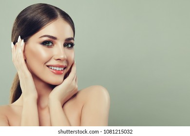 Spa Woman Smiling and Touching her Hand her Face on Banner Background with Copy space for Text. Spa Beauty, Facial Treatment and Skin Care Concept