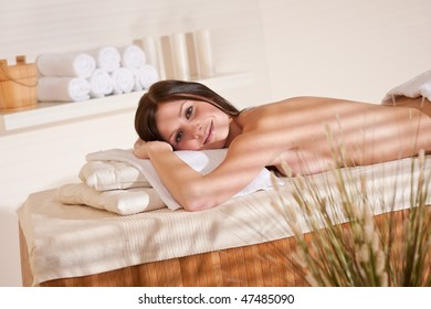 Spa - Young woman at wellness therapy treatment relaxing