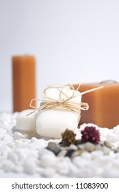 SPA zen candles and soap on white pebbles background,  meditation concept