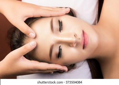 spa,beauty and health concept - beautiful woman in spa salon getting face treatment