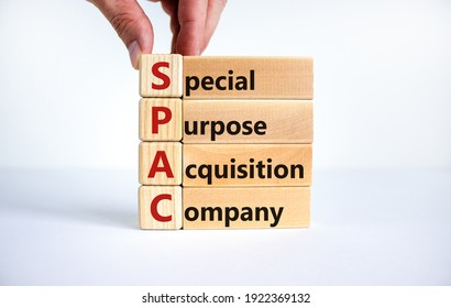 SPAC, special purpose acquisition company symbol. Businessman holds cubes with words 'SPAC' on beautiful white background, copy space. Business and SPAC, special purpose acquisition company concept.