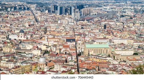 Spaccanapoli, Naples Italy.  View of Spaccanapoli street splitting city center; business district skyscrapers are in the background