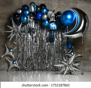 Space balloons photo zone with blue and silver stars for child kids birthday party decor. Holiday decoration. Children party background