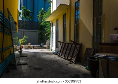 Space between yellow townhouse