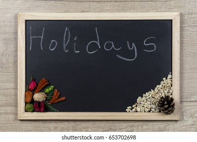 """Space chalkboard background texture with wooden frame with the word """"Holidays"""". blackboard space for wallpaper. Landscape mounting style horizontal."""