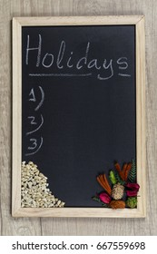 """Space chalkboard background texture with wooden frame with the word """"Holidays"""". blackboard space for wallpaper. Landscape mounting style vertical."""