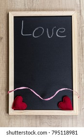 """Space chalkboard background texture with wooden frame with the word """"Love"""". blackboard space for wallpaper. Landscape mounting style vertical."""