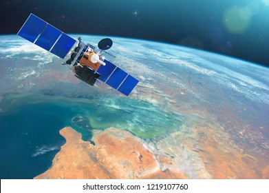 Space communications satellite in low orbit around the Earth. Elements of this image furnished by NASA
