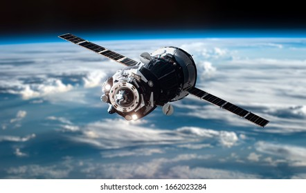 Space craft in outer space near Earth planet. Spaceship. Elements of this image furnished by NASA